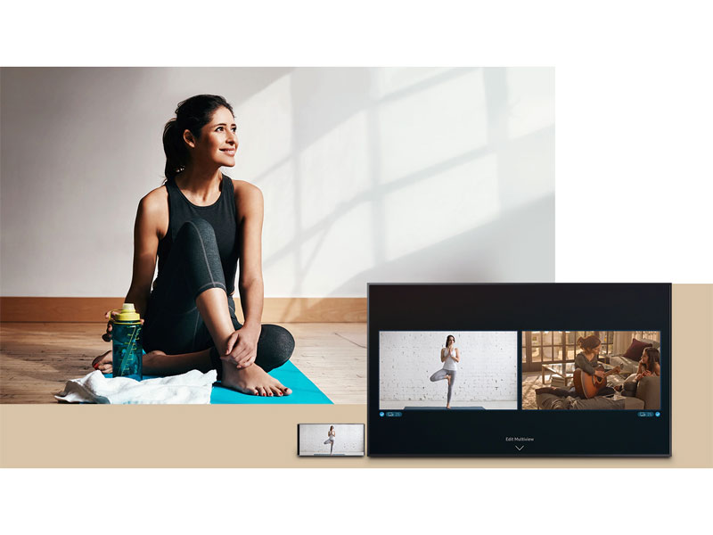 Woman streaming yoga from her smartphone onto The Frame