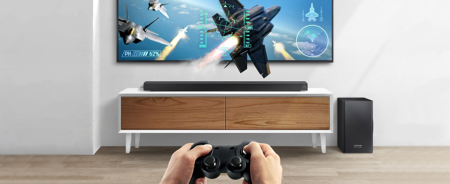 Someone playing a fighter aircraft pilot game on a QLED with the Soundbar below