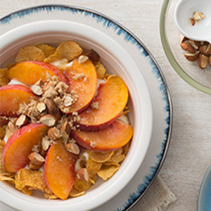 kelloggs, corn flakes, plain yoghurt, peaches, breakfast bowl, perfect bowl, toasted almonds