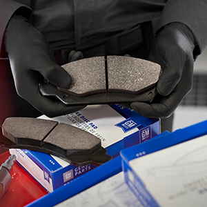 GM Original Equipment Brake Pads Being Unboxed By Shop Mechanic