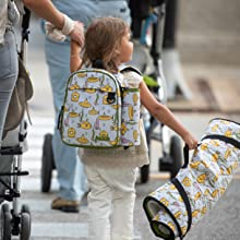 girl walking to school with submarines packie backpack and tot cot nap mat