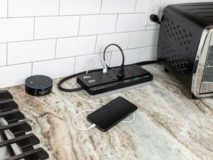 PH6U4X32 on counter with smart phone
