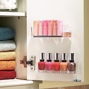 Fingernail polish and lipsticks in caddy on inside of bathroom cabinet door