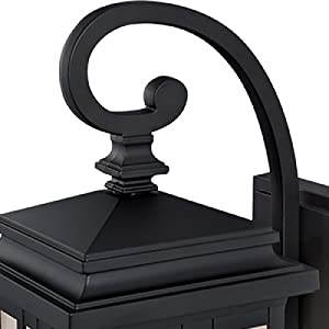 Oil rubbed bronze stepped lantern top, curved arm and linear details.
