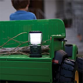 boy riding small truck with lantern in back