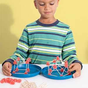Image of young boy conducting a science experiment.