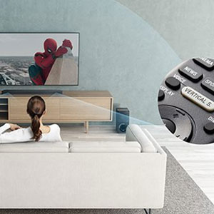 A woman in the lounge room enjoying a movie with a TV and soundbar set-up.