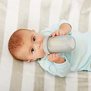 Baby drinking milk with Boon NURSH Reusable Silicone Pouch Bottle