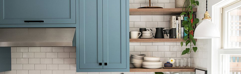 light grey kitchen cabinets with black handles