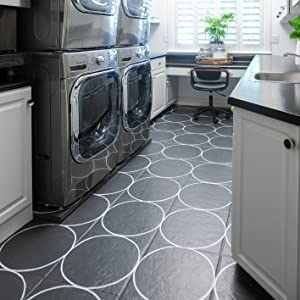 Newly refreshed laundry room with stenciled classic floor pattern