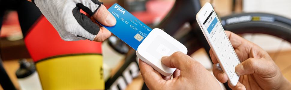 Biker inserting chip card to take payment-