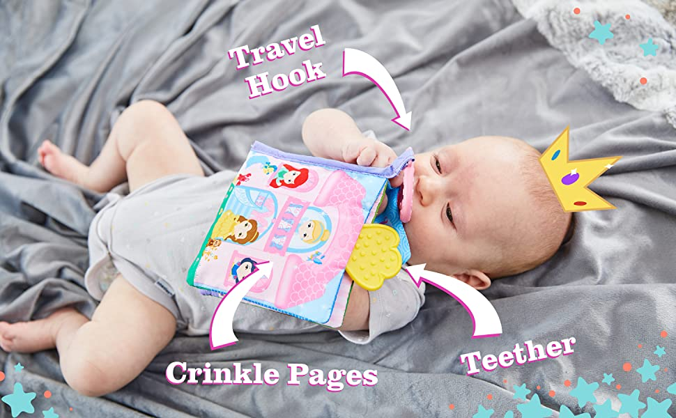 baby playing with Disney Princess soft book