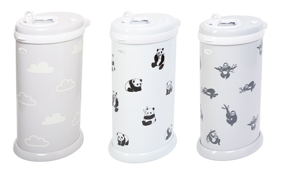 Three Ubbi diaper pails each with cloud, panda, and sloth decals affixed to them
