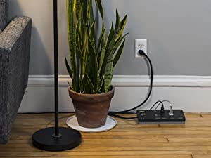 Smart Surge Protector on a living room floor