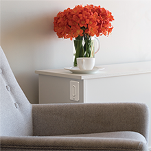 Chair amp; side table featuring the HALO Home Anyplace Dimmer adhered to table