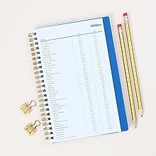 blue sky bakah blue academic planner,closeup of holidays page,desk setup with pencils
