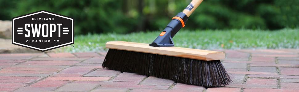 push broom on brick patio