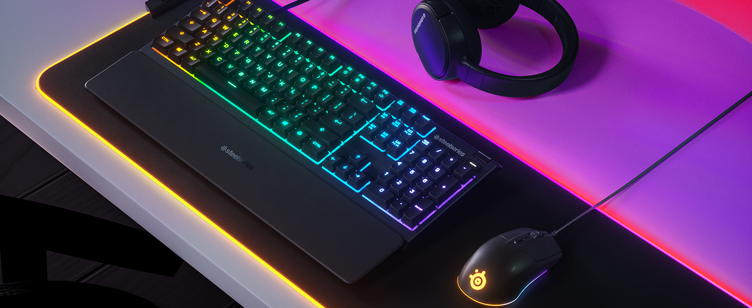 - SteelSeries desk setup with Rival 3 mouse, Apex 3 keyboard, Arctis headset, and QcK Prism mousepad