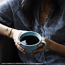 A better cup of coffee from Starbucks held in hands