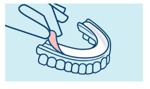 Coloque una almohadilla Algasiv seca sobre la dentadura limpia.