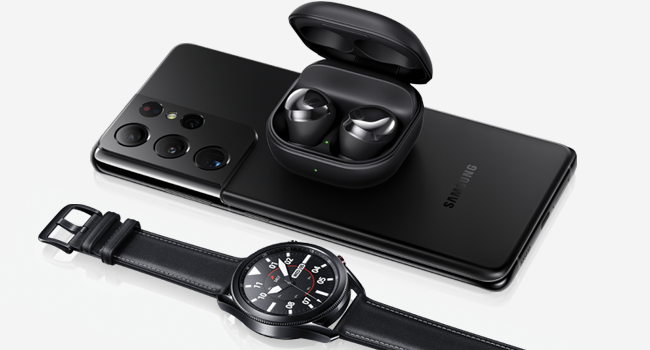 Galaxy Buds Pro Black sitting on top of the back. Galaxy Watch 3 Black next to the phone.