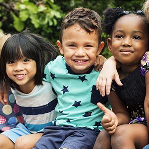 kindergarten kids arm in arm