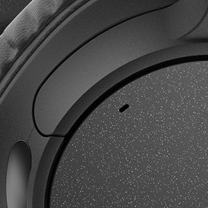 Detail pictureof the built-in microphone on the WH-CH700N headphones