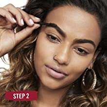Woman filling in her eyebrows using the Brow This Way Eyebrow Sculpting Kit