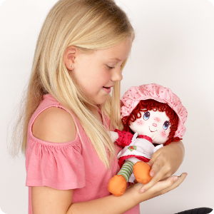 Lifestyle image of girl with doll