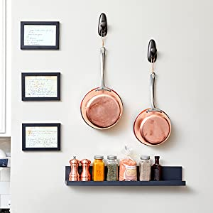 Slate Picture Ledge used as a Spice Rack in the kitchen next to framed recipes