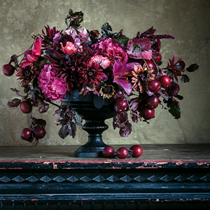 deep purple and blue flower arrangements against a gray backdrop