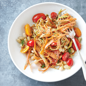 Pesto carrot noodles with white beans and tomatoes