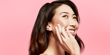 model applying rosilliance to cheek