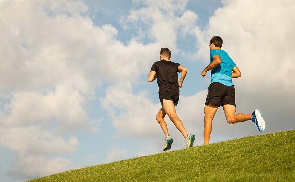 Men running on hill