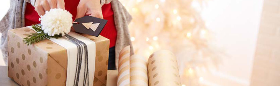 Christmas gift wrap supplies by Hallmark including ribbon, bows, wrapping paper and tissue paper