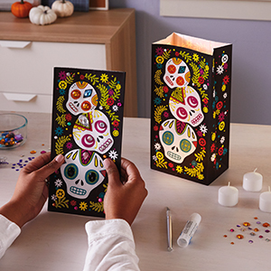 Day of the dead treat bags with colorful sugar skulls for care packages, treat bags, and luminaries