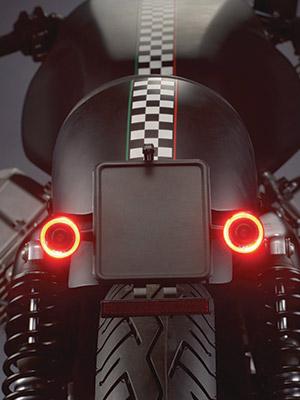 Motorcycle rear close up of Kuryakyn by Kellerman Bullet 1000 lighting for run turn brake function.