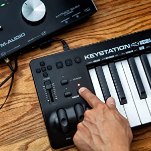 Compact 49-Key USB-Powered MIDI Keyboard Controller with Assignable Controls