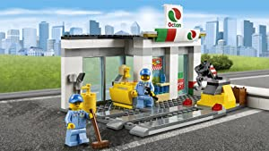 Service station with lift, attendant, and mechanic