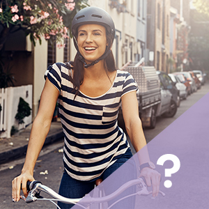 Happy young female on a bike, feeling protected with Always Liners