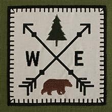 """""""Tree, Bear, East, amp; West"""" embroidered dishtowel."""