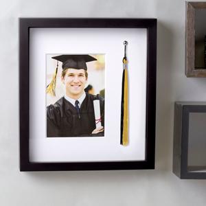 pearhead tassel frame on wall in setting