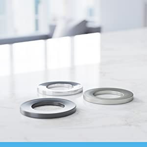 Sink rings stylishly stabilize a round-bottomed sink against a flat vanity surface.