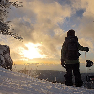 Snowboarder looking at the sunset
