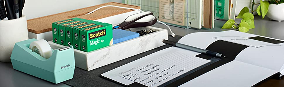 Scotch Home & Office Tapes in a dispenser and boxed packaging on a desk