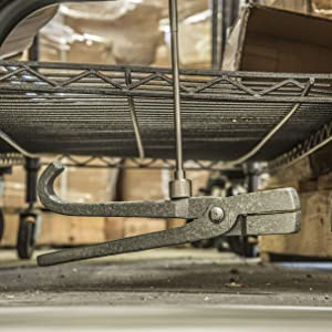 Pick up tool picking up fallen pliers under cart
