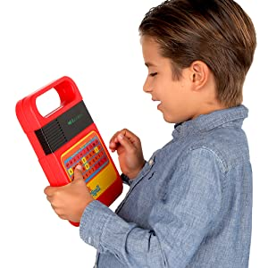 Kid playing with Speak and Spell