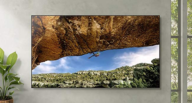 UHD TV with a scene with a rock climber
