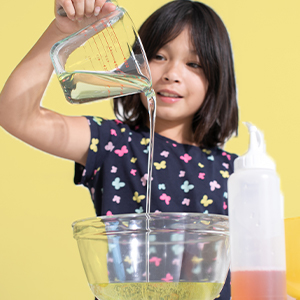 Image of young girl conducting a science experiment.