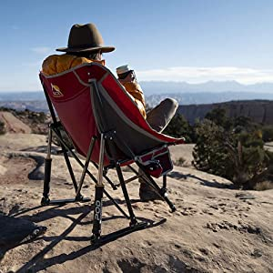 Man sitting on Pod Rocker Collapsible Rocking Chair